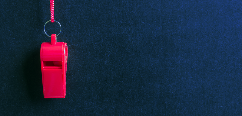 Red whistle on blue background